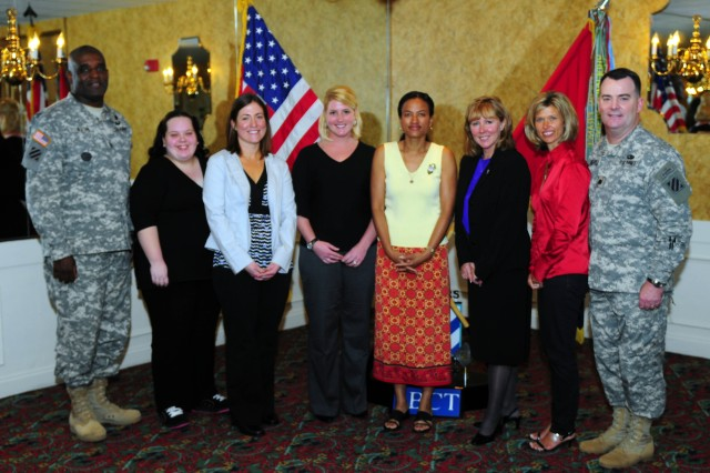 First HBCT Command Sergeant Major Edd Watson (left) and 1st HBCT Deputy Commander Lt. Col. Stanley Fugate (right) pose with FRG volunteer award winners March 18 at Club Stewart. Pictured from left to right are Watson; Krystle Freeman; Valerie Grover; Lauren Deem; Diane Cloutier, wife to 1st HBCT Commander Col. Roger Cloutier; Twyla Balcer and Terri Houlahan. Not pictured is volunteer Lavonna Hamilton.