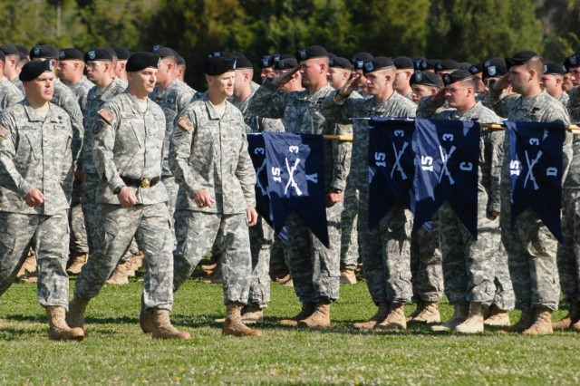 Colonel Lou Lartigue, 4th IBCT  incoming commander; Maj. Gen. Tony Cucolo, 3rd ID commander; and Col. Tom James, outgoing Vanguard commander inspect the troops during the 4th IBCT, 3rd ID's change-of-command ceremony, March 19 at Fort Stewart's Cottrell Field.