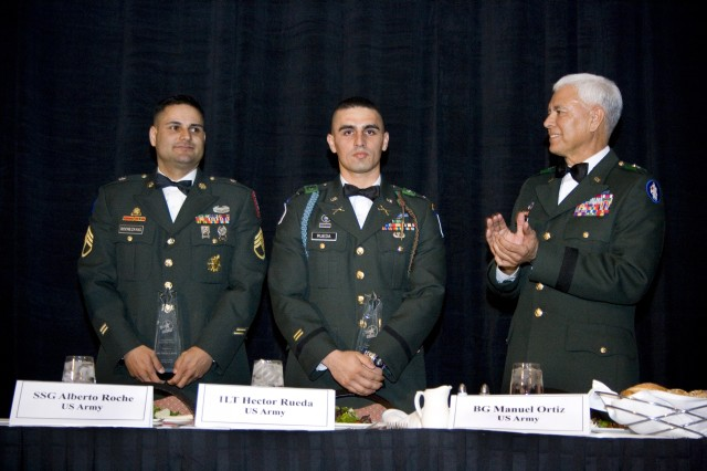 Staff Sgt. Alberto Rochezayas, Chicago Recruiting Battalion, and 1 Lt. Hector Rueda, 4th Brigade, 10th Mountain Division, are awarded the U.S. Army Citizen-Soldier Leadership Award during the U.S. Hispanic Leadership Institute's annual conference Thursday, March 19.  Brig. Gen. Manuel Ortiz, Commander, U.S. Army South, presented the awards during the award dinner in the Chicago Ballroom at the Sheraton Hotel and Towers in downtown Chicago.