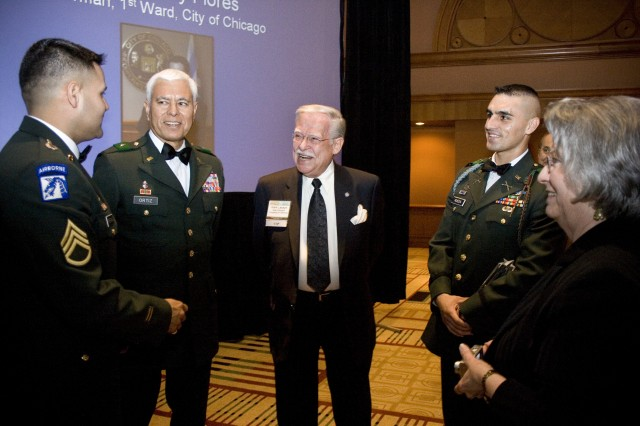 Staff Sgt. Alberto Rochezayas, Chicago Recruiting Battalion, speaks with Brig. Gen. Maunel Ortiz, Commander, U.S. Army South; Hank Lacayo, co-founder and first Board Chairman of the U.S. Hispanic Leadership Institute (USHLI); and 1 Lt. Hector Rueda, 4th Brigade, 10th Mountain Division, after the annual USHLI award dinner at the Sheraton Hotel and Towers in downtown Chicago, Thursday, March 19.  Rochezayas and Rueda received the U.S. Army Citizen-Soldier Leadership Award for their outstanding leadership and contributions to their communities.