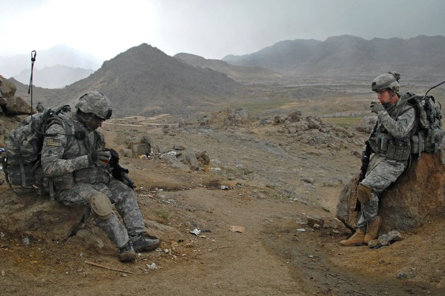 U.S. Army Staff Sgts. Danieto Bacchus, left, and Robert Newman, take a break and drink chai tea at an Afghan National Army outpost near Forward Operating Base Baylough in Zabul province, Afghanistan, March 18, 2009. The Soldiers are assigned to Company B, 1st Battalion, 4th Infantry Regiment.