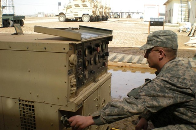 CAMP TAJI, Iraq - Pfc. Charles Coffman, a Corsicana, Texas native, tests a generator during his daily preventive maintenance checks and services.  The network extension platoon relies on 10-kilowatt generators as part of its power distribution plan to ensure continuous voice and data network operations. Coffman is currently deployed with Bravo Company, 10th Sustainment Brigade Troops Battalion, 10th Sustainment Brigade in support of Multi-National Division - Baghdad.  (U.S. Army photo by 2nd Lt. Robert Busby, Co. B, 10th SBTB, 10th Sust. Bde.)
