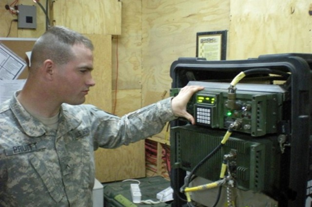 CAMP TAJI, Iraq - Pvt. Robert Pruitt, a Fayetteville, N.C. native, and a Soldier of Bravo Company, 10th Sustainment Brigade Troops Battalion, 10th Sustainment Brigade, checks signal strength on the dismounted line of site radio transmission system.  The DLOS provides high-capacity two-way voice and data transport capabilities through terrestrial line-of-site communications.  The network extension platoon operates this critical network system for the 10th Sust. Bde.  (U.S. Army photo by 2nd Lt. Robert Busby, Co. B, 10th SBTB, 10th Sust. Bde.)