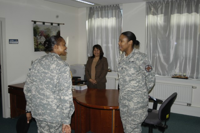 Command Sgt. Maj. Tracey Anbiya, IMCOM-Europe, meets USAG Brussels Chaplain's Assistant Sgt. Markita James, during her tour of the garrison on March 18.