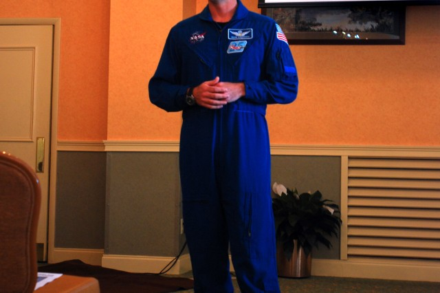 Lieutenant Colonel Shane Kimbrough, a U.S. Army Astronaut, speaks to Soldiers and civilians about his recent mission on the Space Shuttle Endeavour, March 19 at Hunter Club.