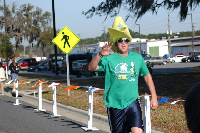 Specialist Joseph  Volz, 603rd ASB, CAB, received a special award for the most festive St. Patrick's Day attire worn in the race. He accepted a certificate for a one-night stay for two from the Inn at Ellis Square in Savannah, along with complimentary cocktails, in the huge green cowboy hat that he wore while running.