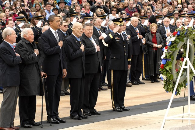 Retired Navy Capt. Thomas J. Hudner, an 84-year old Korean War veteran; Retired Navy Lt. John W. Finn, a 92-year old veteran of World War II; President Barack Obama; Retired Army Col. Robert L. Howard, a 69-year old Vietnam veteran; retired Air Force Col. Joe M. Jackson, an 85-year old Vietnam War veteran and Maj. Gen. Richard J. Rowe Jr., commander, Military District of Washington, gather at the Tomb of the Unknowns at Arlington National Cemetery, March 25, to lay a wreath in tribute to the 3,465 Americans who have received the Medal of Honor.