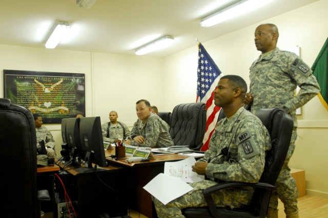 CAMP LIBERTY, Iraq - Col. Byron Freeman (standing), commander of the 8th Military Police Brigade, Multi-National Division-Baghdad, briefs Lt. Gen. Benjamin Mixon, commander of United States Army Pacific Command, Fort Shafter, Hawaii, and the rest of the command staff on the joint mission progress between the MPs and the Iraqi Police forces.
