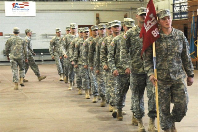 Members of the 86th Engineer Dive Team, 6th Transportation Battalion, march toward the exit of Anderson Field House after their departure ceremony with family, friends and fellow Soldiers bidding them a safe year-long deployment to Kuwait Naval Base in support of Operation Iraqi Freedom.