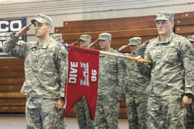 Soldiers of the 86th Engineer Dive Team present arms during the national anthem at Monday's departure ceremony. Commanding the group of about 20 Soldiers is 1st Lt. Joseph Lunn (far left).  During their tour in Kuwait, the team will provide engineer diving support to the Central Command area of responsibility. Operations will include harbor clearance, force protection dives, dam inspections and repairs, ships husbandry and hydrographic engineer reconnaissance.