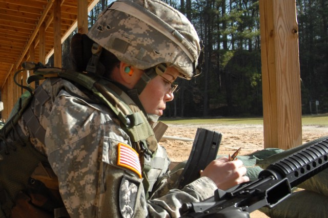 Staff Sgt. Lisa Swanson, a drill sergeant with Company D, 3rd Battalion, 34th Infantry Regiment, is Fort Jackson's NCO of the Year. As she prepares to zero her weapon, Swanson checks her magazine.