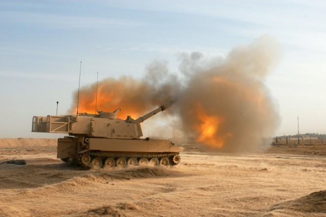 A M109A6 self-propelled 155MM Howitzer, also known as a Paladin, test fires a round on Feb. 13 at Forward Operating Base, Kirkuk, Iraq. The crews were calibrating the Paladins for the first time since arriving in Iraq.