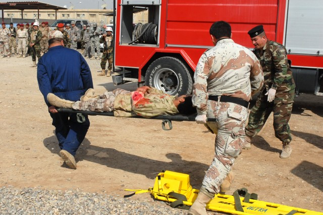 Participants of the combat life saver course at Kirkuk Military Base in Kirkuk, Iraq, take part in a mass casualty training exercise Feb. 24. The participants came from various backgrounds, and are going through the course to learn vital life saving skills.