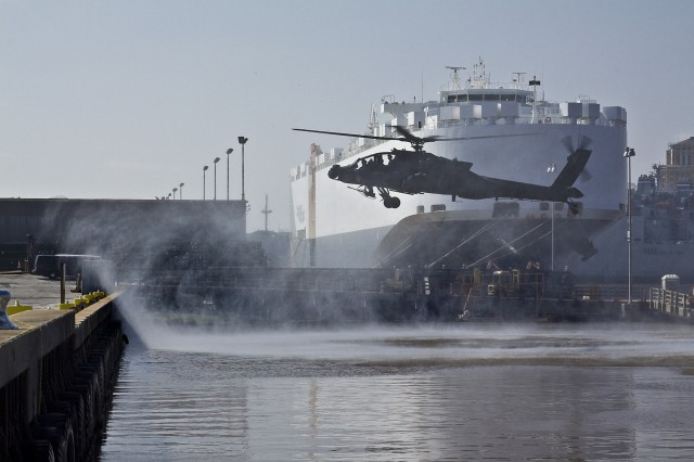 An AH-64D Apache Attack helicopter from 1st Attack Reconnaissance Battalion, 227th Aviation Regiment, 1st Air Cavalry Brigade, 1st Cavalry Division, dusts the wharf at the Port of Beaumont upon its landing, March 17.  The aircraft will be prepped and loaded on to a cargo ship and travel to Kuwait. This is one of the final steps for the 1st Air Cav. Bde., before they make the trip to Iraq in support of Operation Iraqi Freedom.