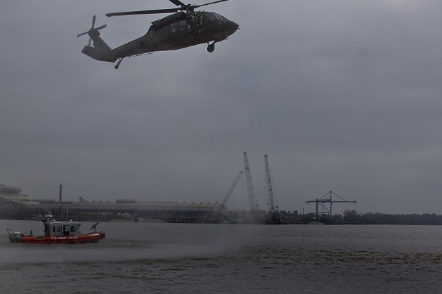 With the Coast Guard present, a UH-60 Black Hawk helicopter from 3rd Assault Helicopter Battalion, 227th Aviation Regiment, 1st Air Cavalry Brigade, 1st Cavalry Division, makes its approach to land at the Port of Beaumont, Texas, March 17. The aircraft will be prepared for transportation to Kuwait for the 1st Air Cav. Bde. deployment into Iraq.