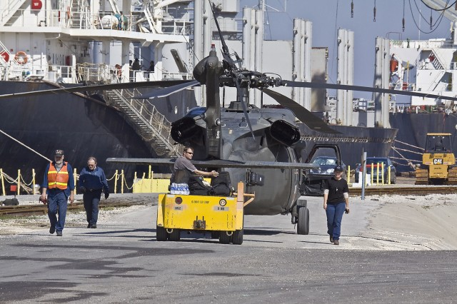 A UH-60 Black Hawk, belonging to 2nd General Support Aviation, 227th Aviation Regiment, 1st Air Cavalry Brigade, 1st Cavalry Division, is handed over to civilian contractors working for Defense Support Services at the Port of Beaumont, Texas, March 16.  The Contractors are breaking the aircraft down and loading them onto vessels for transportation to the Middle East for 1st Air Cav. Bde. deployment to Iraq.