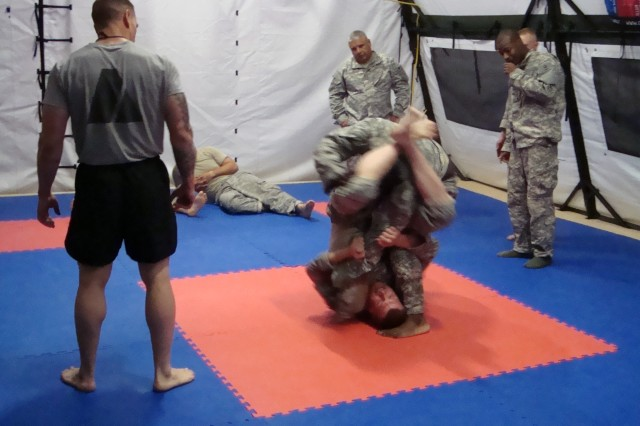 Troops assigned to 2nd Battalion, 7th Cavalry Regiment, 4th Brigade Combat Team, 1st Cavalry Division, grapple during a level-one Modern Army Combatives course held on Forward Operatiing Base Garry Owen March 19.