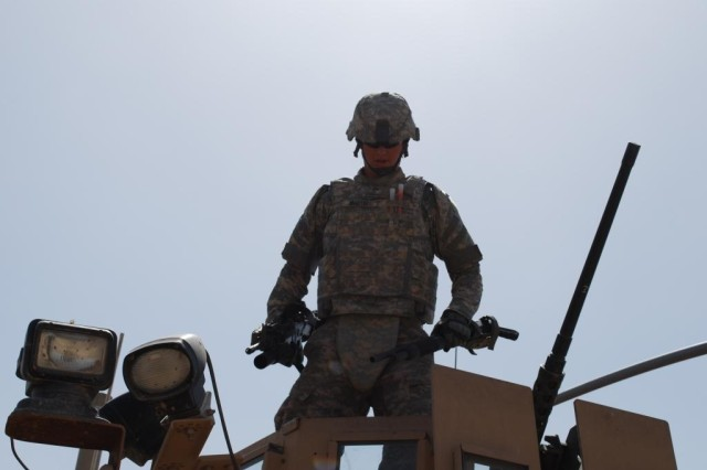CAMP TAJI, Iraq - Sgt. Jared Martin, a Soldier from 2nd Platoon, 62nd Engineer Company, 4th Engineer Battalion, 225th Engineer Brigade, prepares to dismount his vehicle following a successful route clearance patrol March 19.