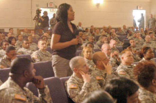 Shamara Dikens, wife of Sgt. 1st Class Shawnrey Dikens, U.S. Army Central Operational Fires and Effects, asks a question during USARCENT's town hall meeting, which was held at the Fort McPherson Post Theater March 18. The meeting focused on the closure of Fort McPherson and USARCENT's move to Sumter, S.C.