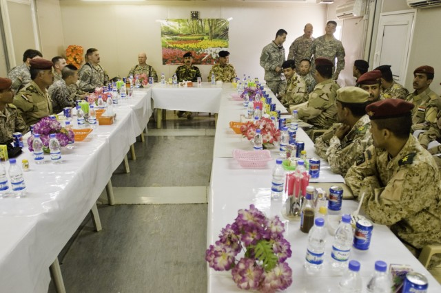 The 10th Iraqi Army Division's 21 newest civil affairs specialists, along with Iraqi military leaders and 304th Civil Affairs Bde. leaders, participate in a civil affairs course graduation ceremony at Camp Dhi Qar officer dining facility March 19.