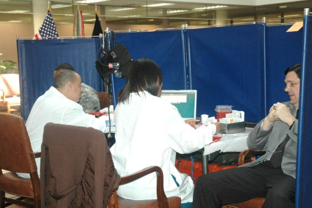 FORT MCPHERSON, Ga. -- Potential donors are screened by Red Cross staff in preparation for donating blood.