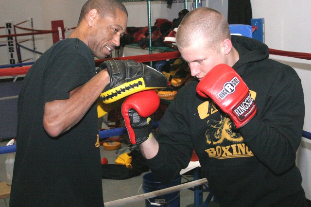Master Sgt. Jeffrey Mays, Army boxing assistant coach, trains Cow Ryle Stous on the mitts to get him prepared for the upcoming national championships. Stous, under Mays' tutelage, earned the national championship last year at 165 pounds.