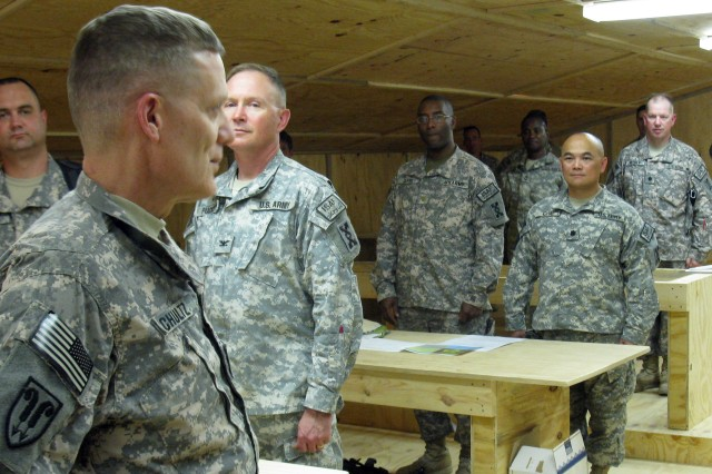 The Commanding General of the 143d Expeditionary Sustainment Command, Brig. Gen. Daniel I. Schultz, surveys his troops at a ribbon-cutting ceremony to officially open the Joint Sustainment Operations Center at the 143d's Joint Sustainment Command Headquarters at Kandahar Air Field, Afghanistan.