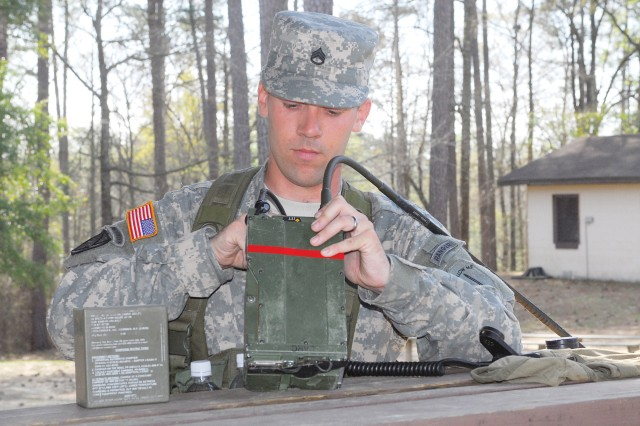 SSG Jackson Perry, B Company, 2nd Battalion, 19th Infantry Regiment, finishes assembling a radio before transmitting a message within his five-minute time limit Tuesday on Sand Hill.