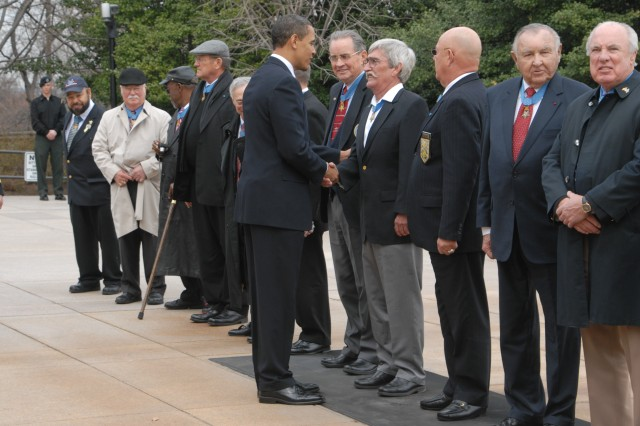 President Barack Obama greets and thanks those who have received the Medal of Honor at the Tomb of the Unknowns at Arlington National Cemetery, Va.