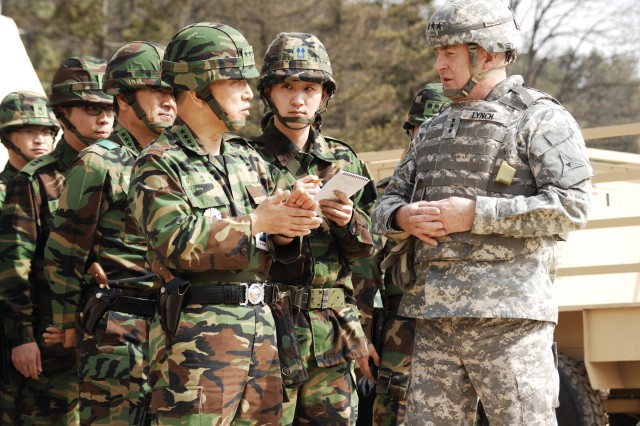Lt. Gen. Rick Lynch, Fort Hood and III Corps commander, leads Gen. Kim Tae-Young, chairman of the Republic of Korea Joint Chiefs of Staff, and Gen. Sang Eui Lee, commanding general of the 3rd Republic of Korea Army, around the III Corps Tactical Command Post during Key Resolve/Foal Eagle 2009. The annual exercise provided an opportunity for the Corps staff to exercise their command and control functions and reinforced the U.S. commitment to the defense of South Korea.