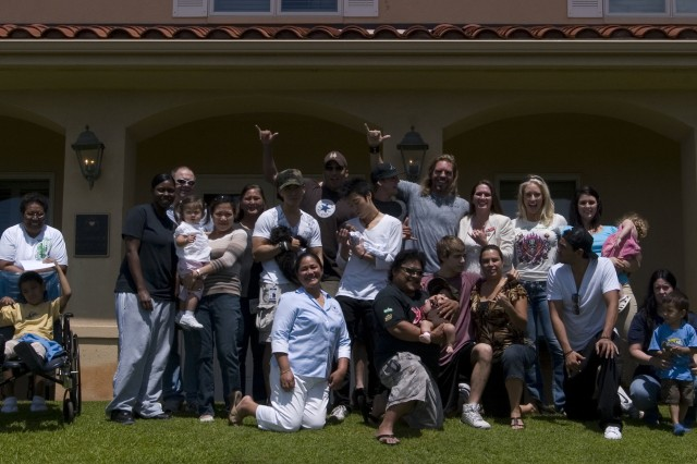 TRIPLER ARMY MEDICAL CENTER, Hawaii - The Hollywood Knights celebrity basketball team poses for a group photograph along with residents of the Fisher House. The celebrities visited the Fisher House, signing autographs and talking story with residents, Wednesday March 18.