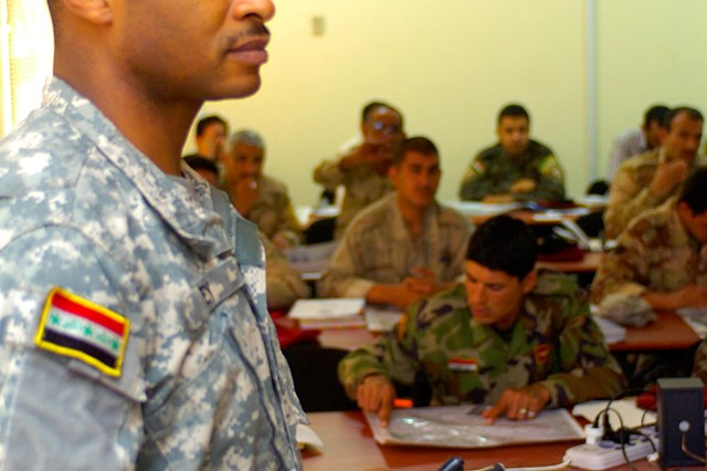 BAGHDAD-Fayetteville N.C. native, Makhayel Bey, a civilian advisor with the 11th Iraqi Army Division Military Transition Team, teaches intelligence collection and basic topography classes to Iraq Army Soldiers, March 22.