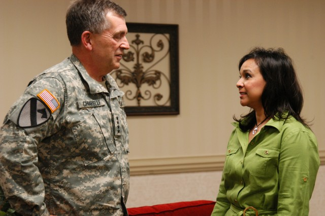 Army Vice Chief of Staff Gen. Peter W. Chiarelli talks with Sandra Stankwicz, wife of the 19th ASOS commander. Stankwicz and other Fort Campbell spouses met with Chiarelli during his visit to the installation. Chiarelli is visiting seven installations over eight days in regards to his focus on suicide prevention.