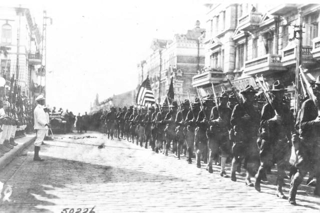A?A,A'a,!A?AuA?A?A'a,!A?A3/4A?A2A?A3/4A?APA?A'A?AoA?A1A''A?Au A?A1/4A?AoA'a,!A''! (Forward March!). American troops parading through Vladivostok. (World War I Signal Corps Photograph Collection).