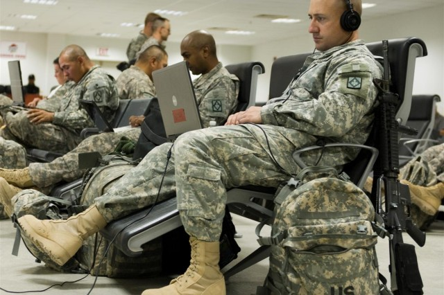 Sgt. 1st Class Mathew T. Greene, the support operations fuel noncommissioned officer in charge with the 100th Brigade Support Battalion from Fort Sill, Okla., relaxes prior to leaving on a flight to Afghanistan with other unit Soldiers at the passenger terminal at Joint Base Balad, Iraq, March 28. The 100th BSB is one of the first Army units to deploy from Iraq to Afghanistan.