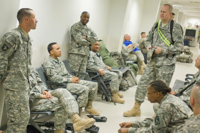 Brig. Gen. Michael J. Lally, the commanding general for the 3d Sustainment Command (Expeditionary), talks with Soldiers of the 100th Brigade Support Battalion at the passenger terminal at Joint Base Balad, Iraq, March 28. The 100th BSB, an active-component unit from Fort Sill, Okla., was repositioned from Iraq to Afghanistan on March 28, to provide logistical support to Coalition forces there.