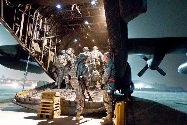Soldiers of the 100th Brigade Support Battalion load onto a C-130 aircraft as they prepare to leave for Afghanistan from Joint Base Balad, Iraq, March 28. Beginning in December 2008, the 100th BSB provided logistical support to Coalition forces in western and central Iraq as part of the 3d Sustainment Command (Expeditionary).