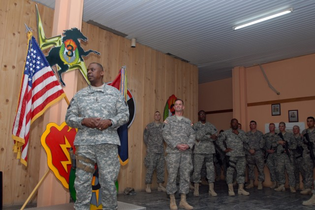 CONTINGENCY OPERATING BASE SPEICHER, TIKRIT, Iraq - Lt. Gen Lloyd Austin, Multi-National Corps- Iraq commanding general, spoke to Soldiers of 3rd Infantry Brigade Combat Team, 25th Infantry Division as Col. Walter Piatt, brigade commander looked on during a visit where Soldiers received Lt. Gen Austin's coin for their outstanding duty performances March 25.