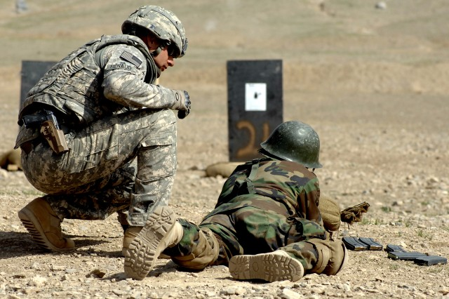 Staff Sgt. Derek Renaud looks on as an Afghan National Army soldier tries zeroing his weapon at Kabul Military Training Center, March 17. The pending deployment of thousands of similar trainers is a key component of President Barack Obama's new Afghanistan-Pakistan strategy.