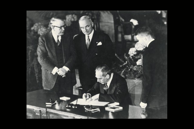 Dean Acheson (Minister of Foreign Affairs) signs the NATO Treaty for the United States April 4, 1949.