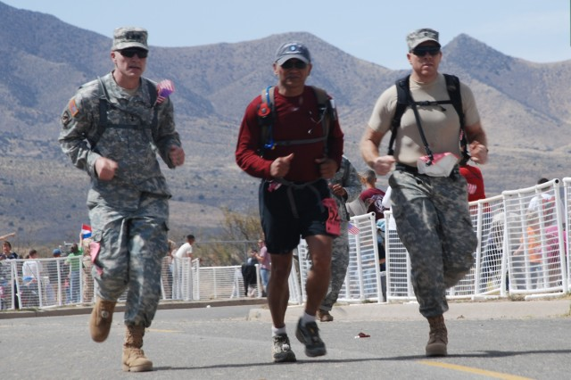 Director of the Army Staff Lt. Gen. David H. Huntoon Jr. (left) sprints to the finish of the 26.2-mile endurance race March 29, along with retired Maj. Gen. Tony Taguba (center) and Lt. Col. Shawn Phillips at White Sands Missile Range, N.M.