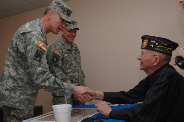 Lt. Gen. David H. Huntoon Jr., director of the Army Staff, shakes hands with Bataan Death March survivor and noted artist, Ben Steele, during pre-race activities for the Bataan Memorial Death March at White Sands Missile Range, N.M.