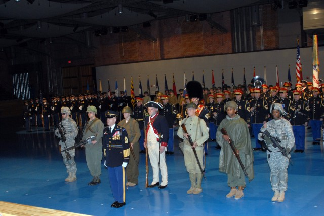 Cmd. Sgt. Maj. David Martel stands in front of Soldiers dressed to represent NCOs through the years.  The uniforms represented Soldiers from the Revolutionary War, World Wars I and II, the Vietnam War, the Korean Conflict, the Global War on Terror, and the Soldiers of the future.