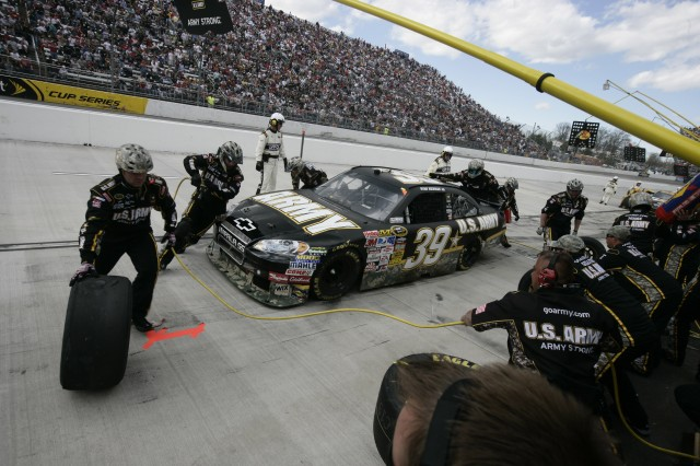 The pit crew for the U.S. Army Chevy changes tires and makes adjustments Sunday during the Goody 500 at Martinsville Speedway.