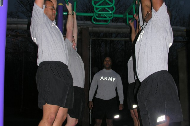 PICATINNY ARSENAL, N.J. - Soldiers prepare to do some pull-ups during an early morning PT session with Marines here March 11.