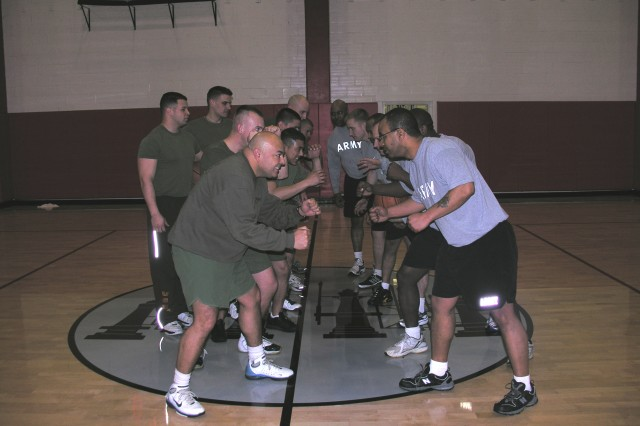 PICATINNY ARSENAL, N.J. - Soldiers and Marines prepare to do battle in a friendly game of basketball during an early morning PT session here March 11.