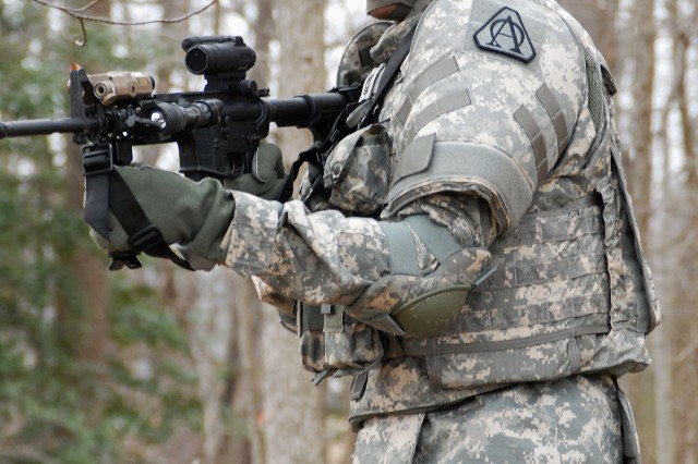 A Soldier uses the new AN/PSQ-20 Enhanced Night Vision Goggles.