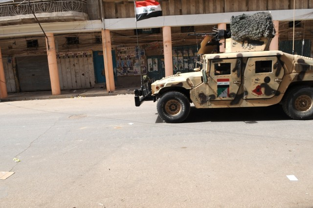 BAGHDAD - An Iraqi Army humvee moves into Baghdad's Fadhil neighborhood after two days of sporadic gunfire between Iraqi Security Forces and Awakening Council militias March 29 following the warrant-based arrest of local Awakening Council leader Adil al-Mashhadani by the ISF. ISF took to the streets in order to restore peace following a series of firefights between ISF and the militia fighters.