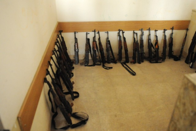 BAGHDAD - Assault rifles line the wall of an Iraqi Security Force's station during an operation to disarm Awakening Council members in the Fadhil neighborhood of eastern Baghdad March 29. Iraqi Security Forces disarmed the group in an effort to restore law and order in the neighborhood following two days of sporadic gunfire. The violence erupted following the warrant-based arrest of local Awakening Council leader Adil al-Mashhadani. ISF took to the streets in order to restore peace in the region. ISF was supported by U.S. forces during the Iraqi-led military operation.