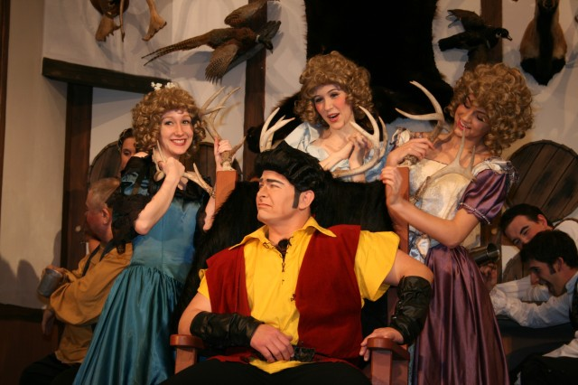 """Master Sgt. Lance Milsted as Gaston is surrounded by admiring ladies in a production of """"Beauty and the Beast."""" """""""